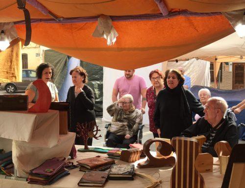 Visita de Centro de Día Abastos al Mercado Medieval de Patraix en Valencia